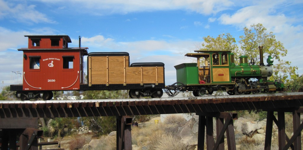 Joshua Tree & Southern 7 ½ inch Railroad Forney posed on one of the steel bridges