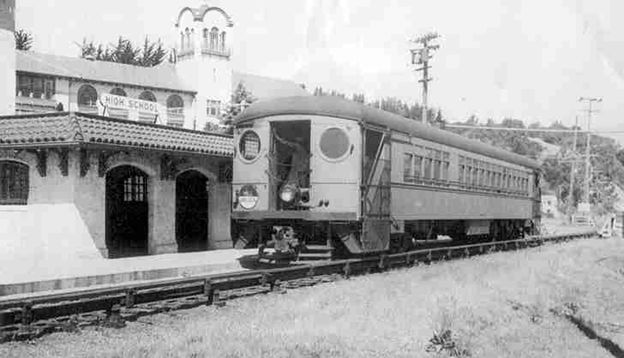 NWP electric passenger motor 383 at High School Station near Mill Valley, July 1937. St. Louis Car Co. 1930. Electric 3rd rail this side of car. Mill Valley Branch electric trains quit on 9/30/40 and the entire NWP interurban system serving San Rafael, San Anselmo and Manor was abandoned 2/28/41.