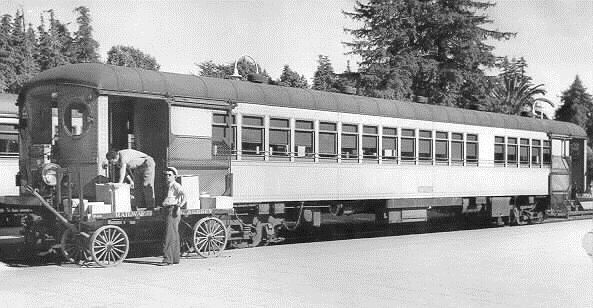NWP interurban 386, arrived from Sausalito, unloads from the front platform special express shipments at Mill Valley Depot, October 1939. 386 was the last of 12 motors and 7 trailers bought new in 1930. It had only 11 years of service until abandonment in 1941, after which it was transformed to Pacific Electric as No. 4511.