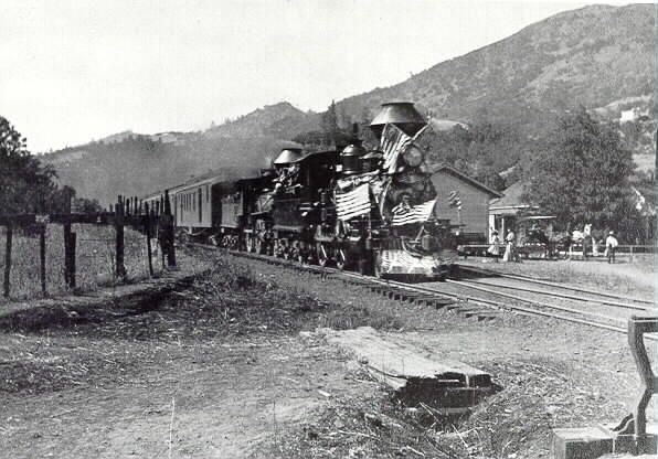 Spirited doubleheader welcomes the Fourth of July in 1904. No. 6 and another 4-4-0 blast past the station at Preston, just north of Cloverdale. It was California Northwestern Railway at that time (the successor to SF&NP after 1898). Looks like an excursion headed for Santa Rosa.