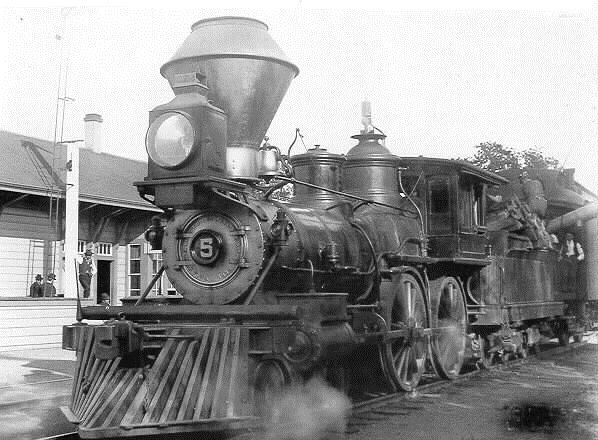 "San Francisco & North Pacific No. 5 ""Santa Rosa"" takes water at Fulton, where the Russian River line branched off. The 5-Spot had been born in San Francisco, as indicated by cast lettering on the front of the smoke box. It reads ""H J Booth & Co., Builders, S.F. Cal. 1873."