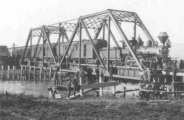 San Francisco & North Pacific first train over the new Petaluma Creek Bridge, 1902 near Petaluma. Loco 16, was formerly #4 on SF&NW.