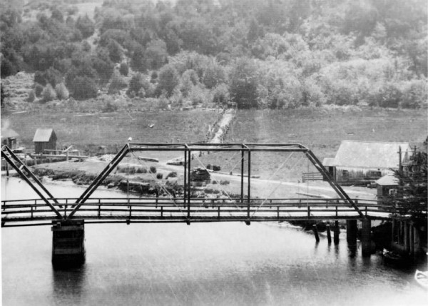 1890 – A photograph showing the road James Townsend built on the south side of Noyo River and the second Noyo Bridge. This was another toll bridge and the small building at the far right end of the bridge was probably the toll house.