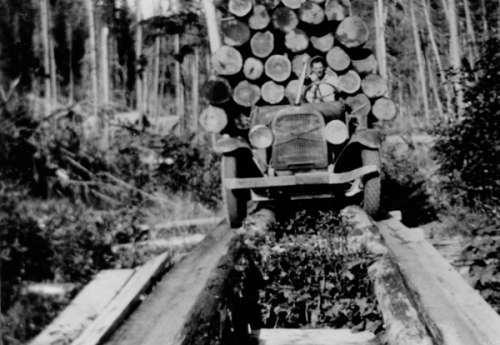 Early logging truck crossing trestle