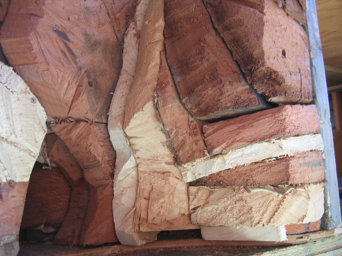 Rocks carved from scrap redwood