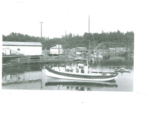1910 fishing boat in Noyo harbour with second noyo bridge in background