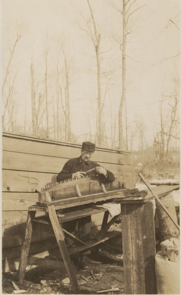 The filer. The filer had his bench in the woods at the dinner shack which saved carrying the saws two miles into camp.