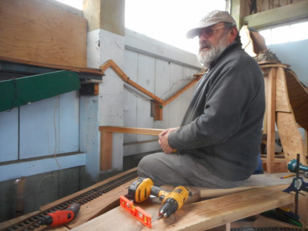 Mike Aplet resting whilst building a model Three Chop Ridg