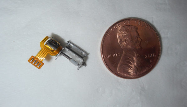 Stepper motor alongside a penny