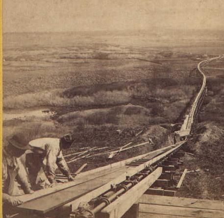 Loading lumber into the Rollerville Flume