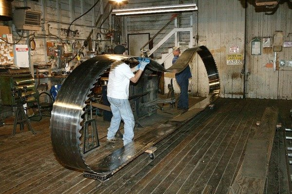 Giant Bandsaw being manhandled