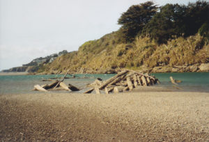 Old log cribs in the estuary of the Gualala River by Harry-Lindstrom