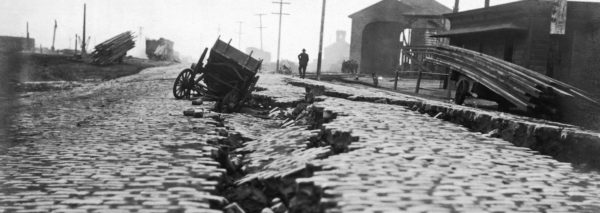 A split on the north end of East Street from the earthquake. East St. is now the Embarcadero. San Francisco, California: 1906.