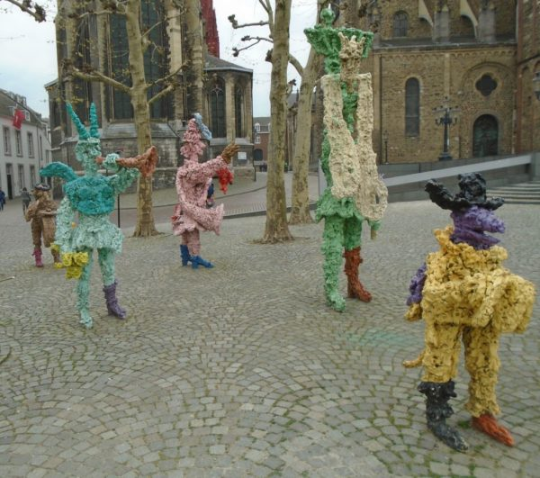 Some weird flower covered figures in a corner of the main square