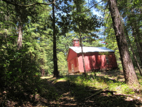 The Caspar Lumber Company's little red schoolhouse on CA Route 20